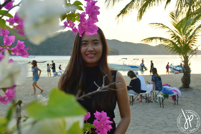 beach, sand, bougainvillea, woman striking a pose for the camera, benches, adults chilling at the beach