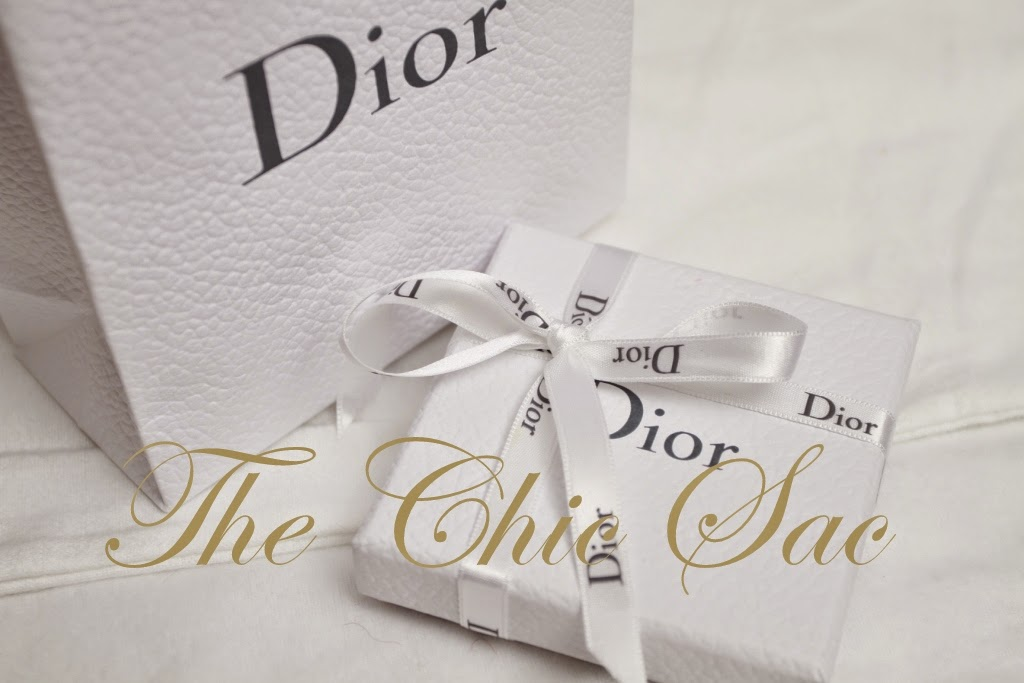 d8f83cde30f7 Prada Authenticity card, Prada Box and Prada paperbag included. Christian  Dior Tribal Two-Tone Earrings