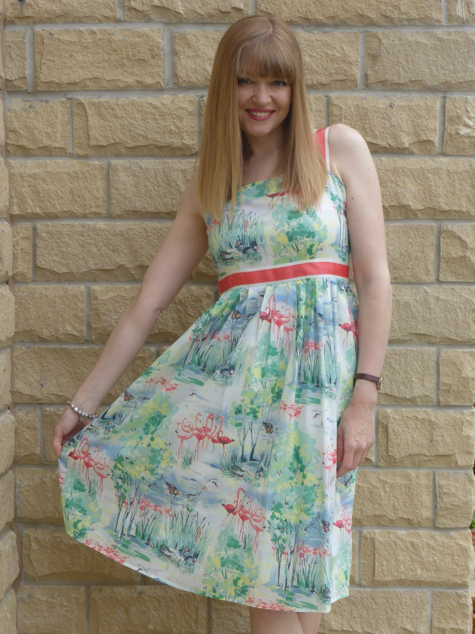What Lizzy Loves, over 40 blogger wears summer flamingo print dress and silver wedge sandals