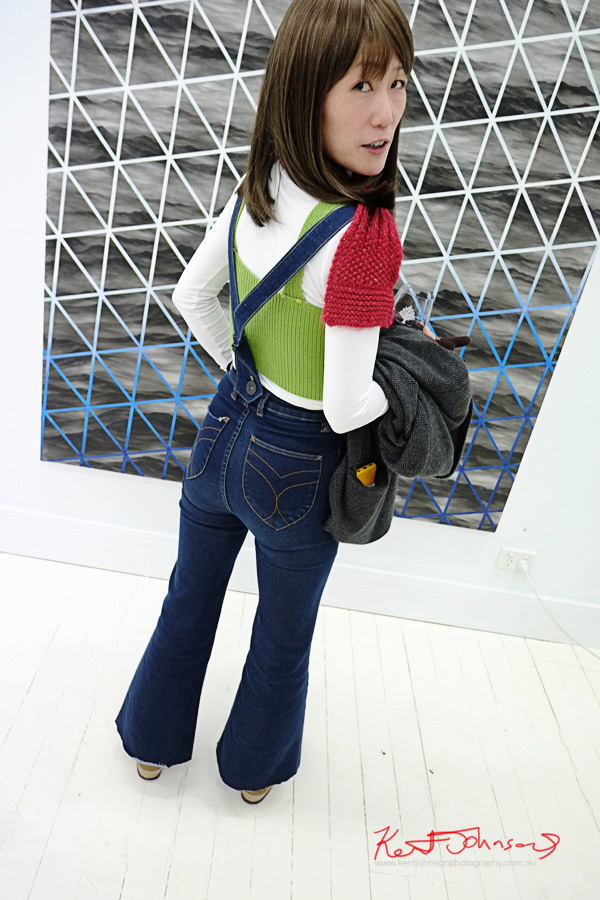 Funky winter knits, green red, flared denim overalls. Street Fashion Sydney by Kent Johnson.
