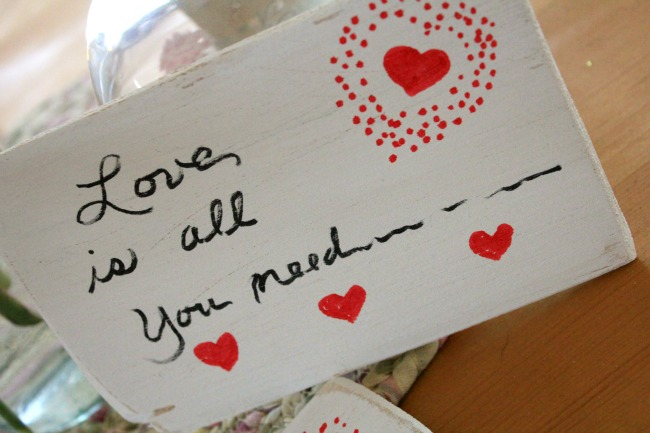 Make a balsa wood Valentine postcard.