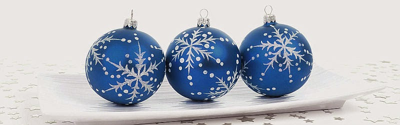 Christmas tree globes setting in a dish for a homemade Christmas centerpiece decoration