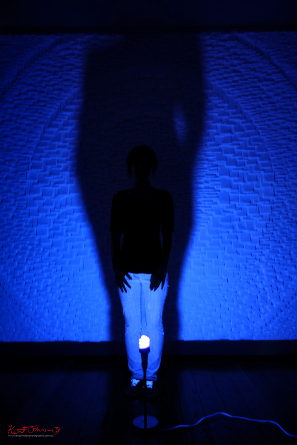 Rachel J Park artist portrait with installation 'I AM' under ulrtaviolet light, Accelerator Gallery - Pyrmont Sydney.