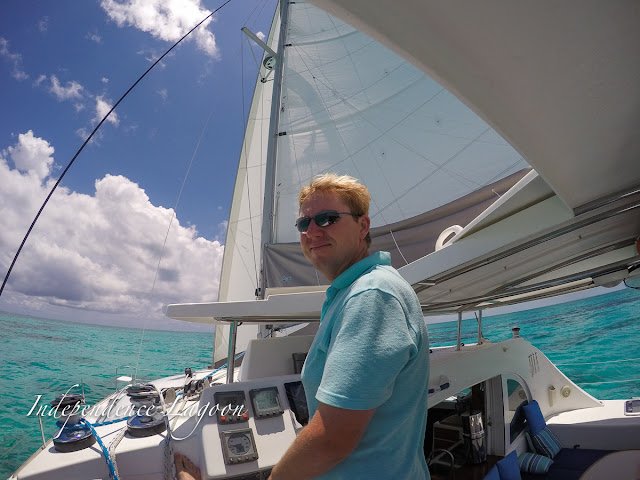 Matt at the helm of Independence, a Lagoon 380 sail catamaran