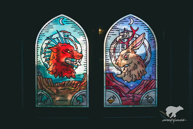 Super dope stained glass prints on the windows of Preacher Gallery.