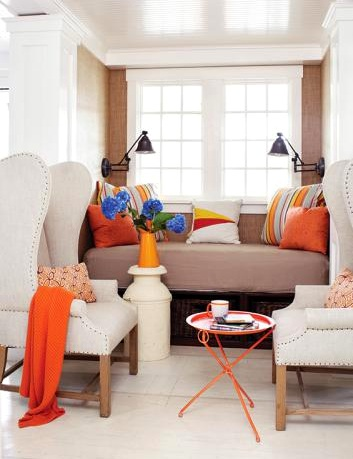 sitting nook with orange pillows