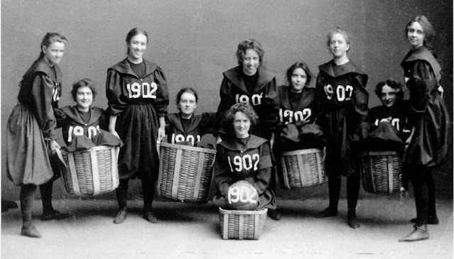 Smith College Class of 1902 girls basketball team. Player hold up teammates sitting in baskets. Baskets and Ladders. marchmatron.com
