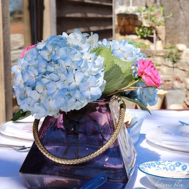 blue-hydrangeas-purple-square-vase-centerpiece-spring-garden-party