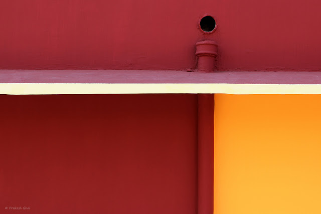 A Red Orange Wall of a Kindergarten School with Simple Geometric Shapes shot via Canon 600D and Canon 100 mm prime Macro L Series F2.8 lens