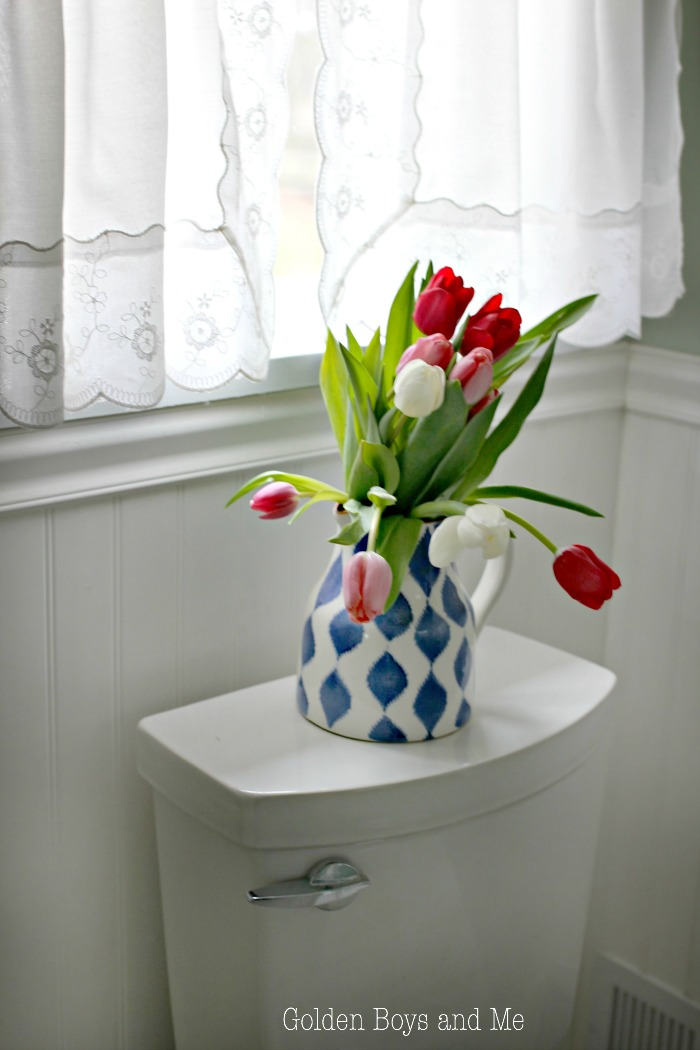 Tulips add some color in bathroom - www.goldenboysandme.com