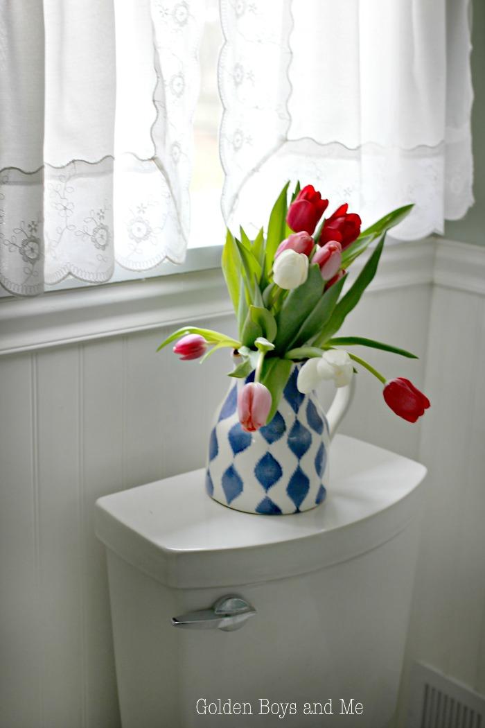 Tulips add some color in bathroom - www.goldenboysandme.com