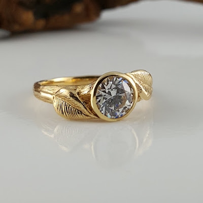 Hand sculpted leaves on a branch style band with a 1 ct Moissanite Diamond, solid 14k Yellow Gold Show