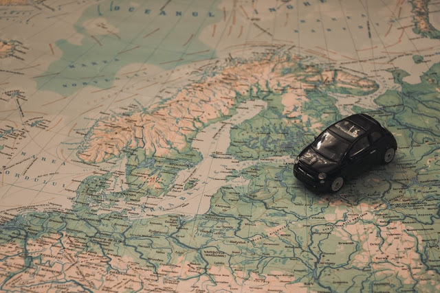 map and toy car