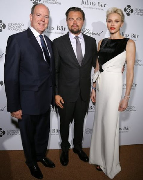 Princess Charlene of Monaco, Prince Albert II of Monaco and Milutin Gatsby arrive at a cocktail during The Leonardo DiCaprio Foundation 3rd Annual Saint-Tropez Gala at Domaine Bertaud Belieu on July 20, 2016 in Saint-Tropez, France.