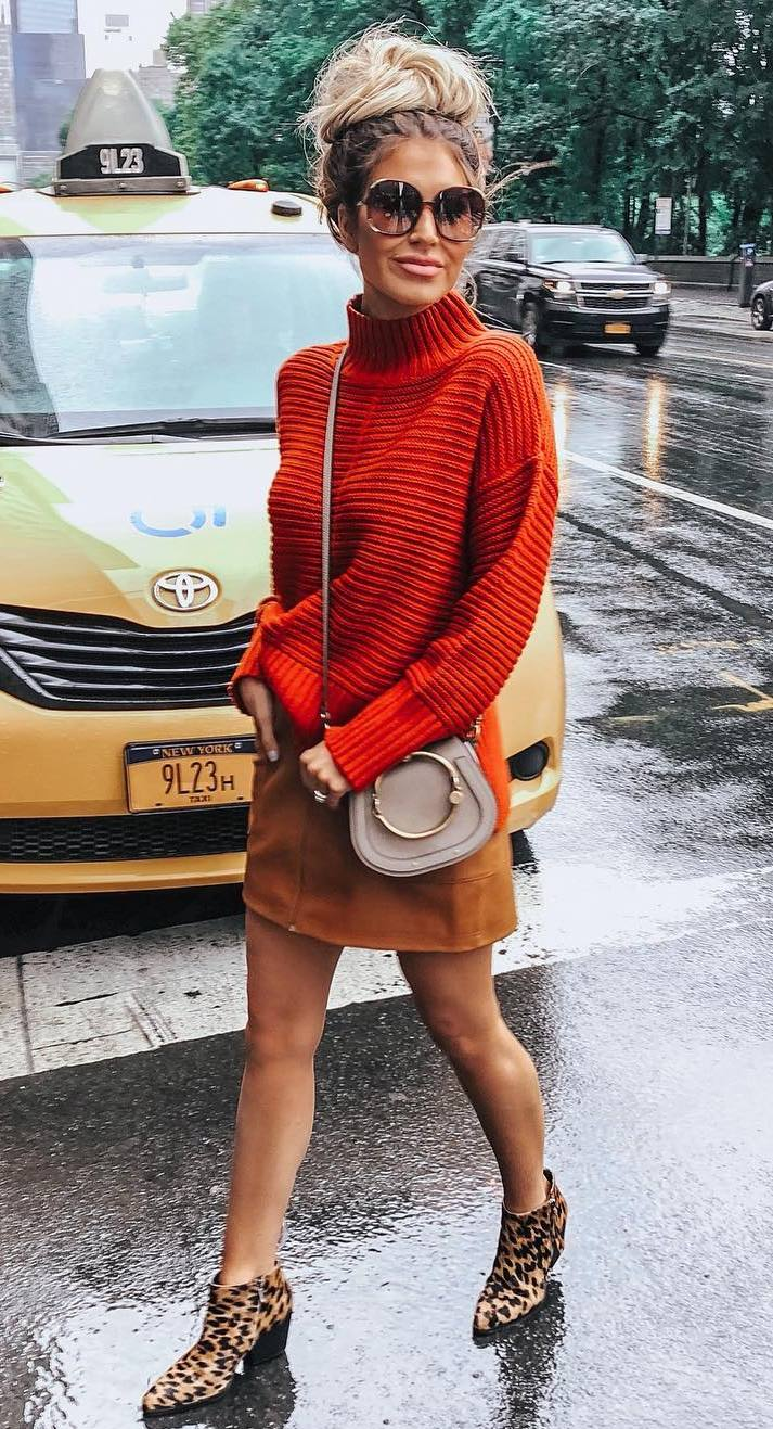 what to wear with a red sweater : brown skirt + crossbody bag + boots