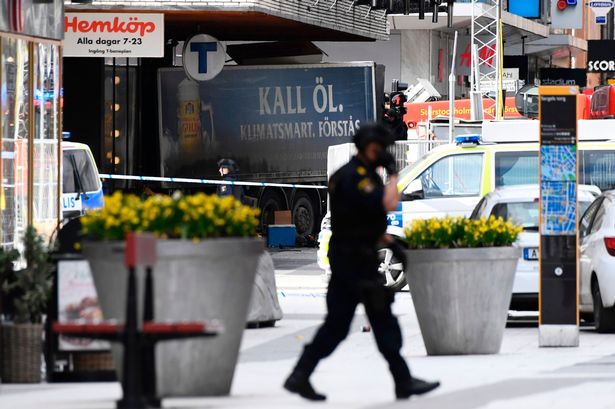 truck into pedestrians at a local department store killing 3