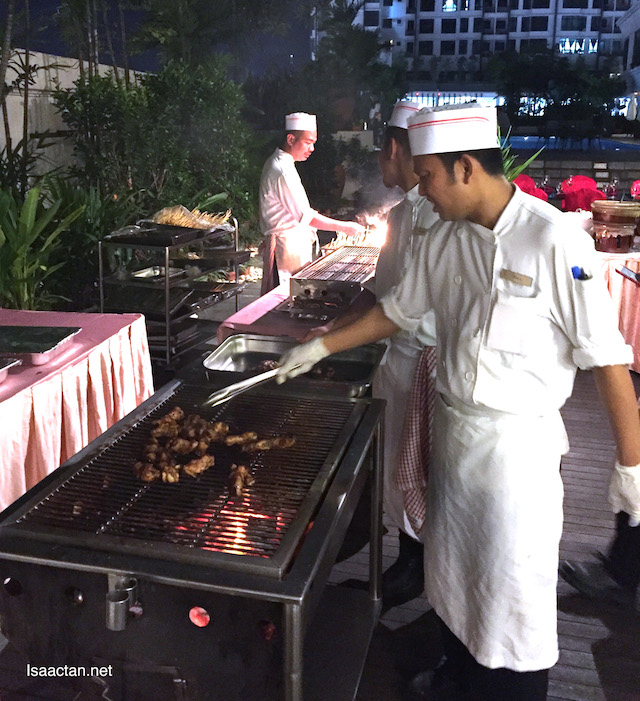 Chefs barbecuing our meat by the poolside