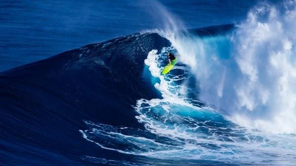 Surfer and Paraglider