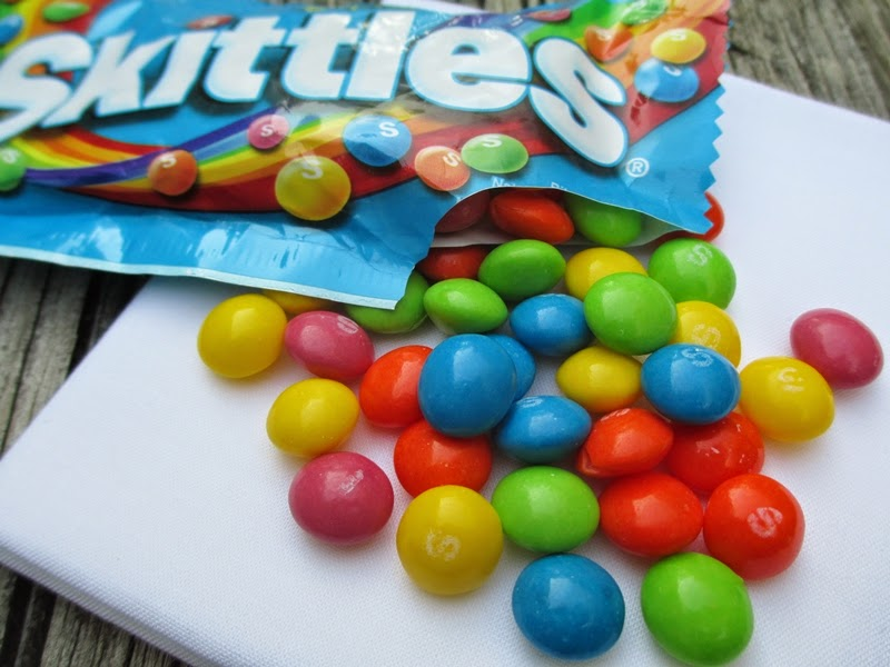 Tropical Skittles spilling out of bag.