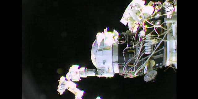 Williams and Rubins work to attach adjustable tethers to IDA-2 in order to secure it to PMA-2 to allow for Dextre to release its grip. Photo Credit: NASA TV