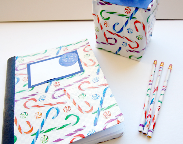 wrapping paper diy composition book, tissue box and 3 pencils