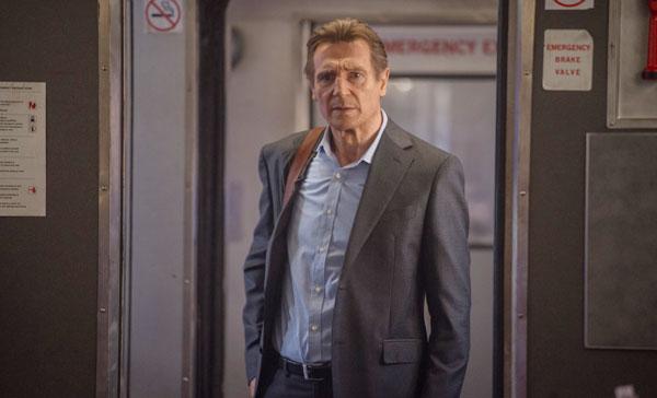 Liam Neeson boards the train in THE COMMUTER (2018)