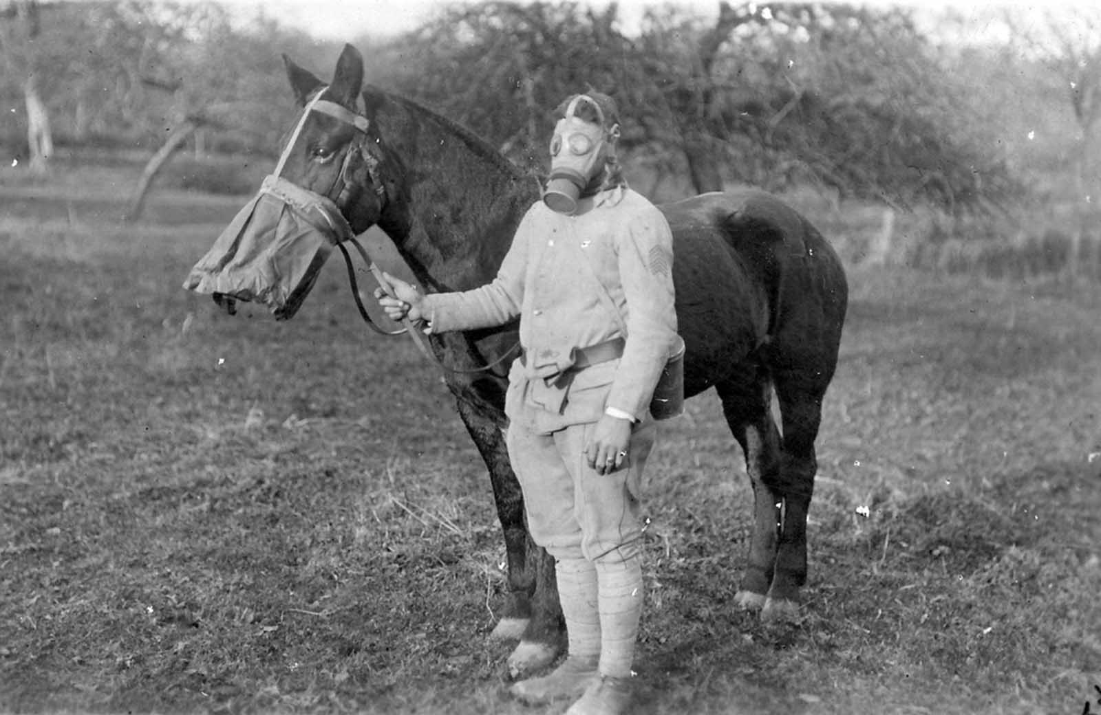 A soldier and his horse in gas masks, ca. 1918.
