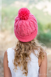 http://www.ravelry.com/projects/Auriga/candy-cables-hat-3