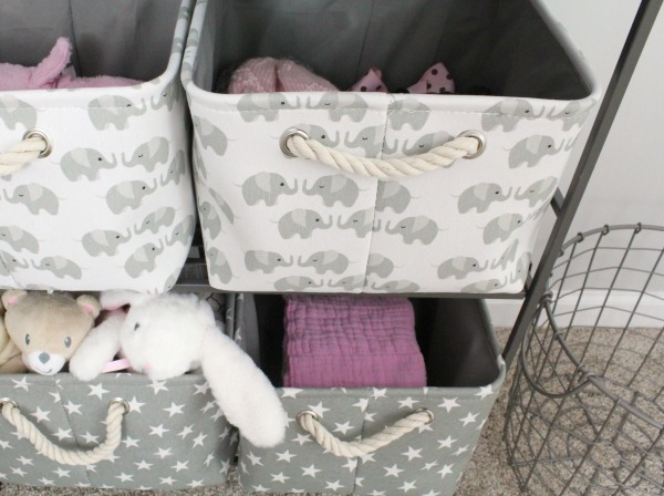 Gray white and light pink nursery for a baby girl- Gray canvas and rope storage baskets with stars and elephants