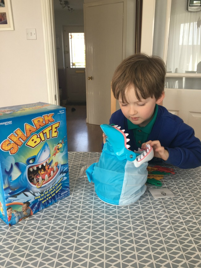 Shark-Bite-Lets-Go-Fishing-and-Mr-Bucket-goliath-games-Toy-Review-image-of-boy-with-shark-bite-game