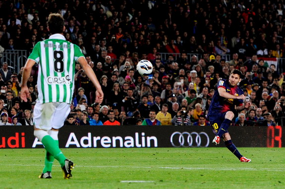 Barcelona forward Lionel Messi scores his team's third goal against Real Betis with a free-kick