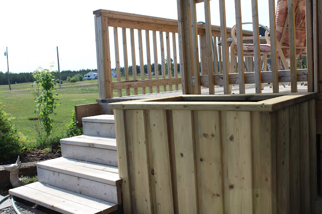 planter beside deck stairs