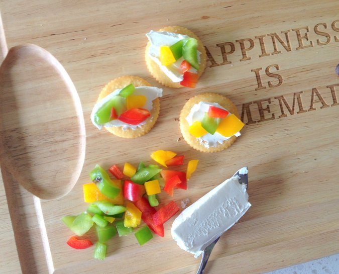 Cream cheese and pepper cracker topping