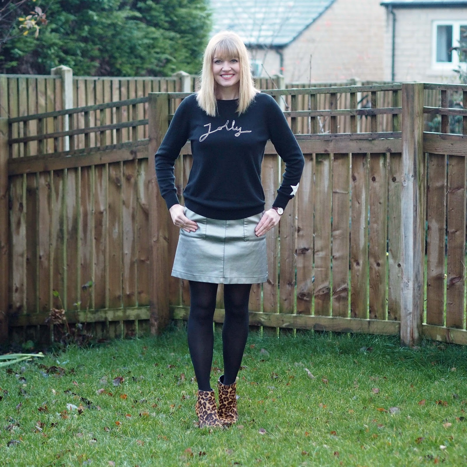 Stylish Christmas jumper with metallic leather look mini skirt, leopard print heeled boots over 40