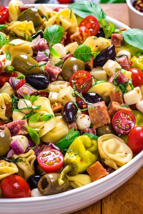 Antipasto Tortellini Pasta Salad. This potluck favorite is packed with cheeses, meats, olives, peppers, and more for a hearty Italian summer side dish.