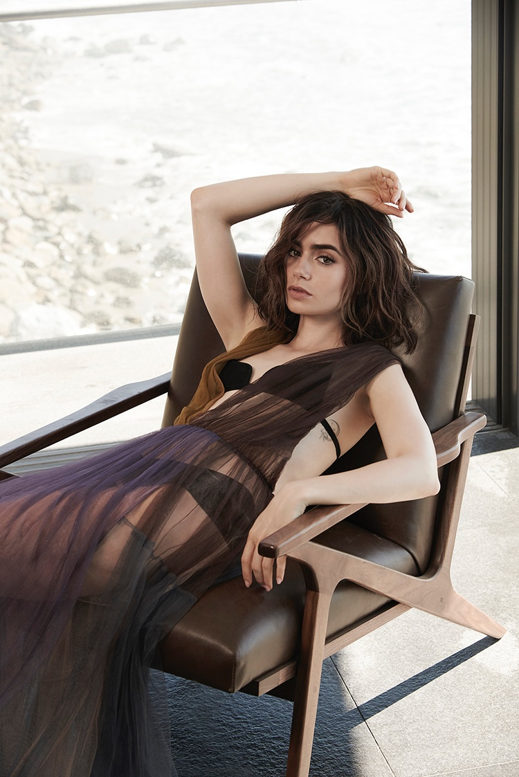 Actress Lily Collins poses in sheer dress from Vera Wang