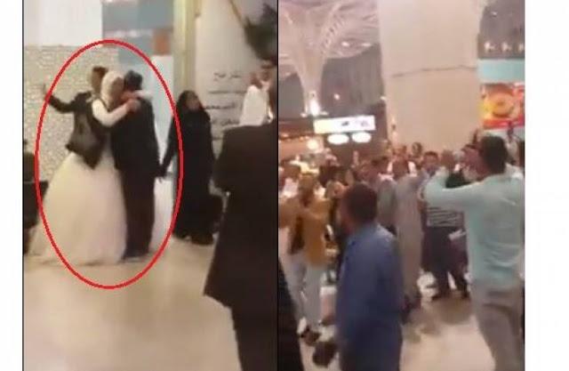 هذا ما حدثَ لعريس مصريّ حَمَلَ عروسه ورقص بها في مطار المدينة المنورة أمر ربما لم يكن بالحسبان