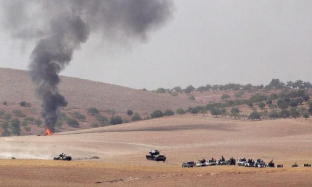 Syrians angry as Turkey sends armoured tanks across border to fight ISIS terrorists on Syrian soil