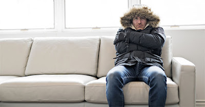 Man sitting in home with no heat