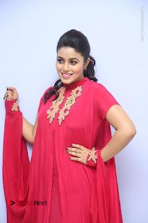 Actress Poorna Latest Stills in Red Dress at Rakshasi First Look Launch  0075.JPG