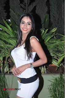 Actress Model Pooja Sri Stills in White Short Dress at F Club pre soft Launch  0029.JPG