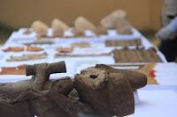Wood sculptures and other relics found at Peru's Chan Chan site