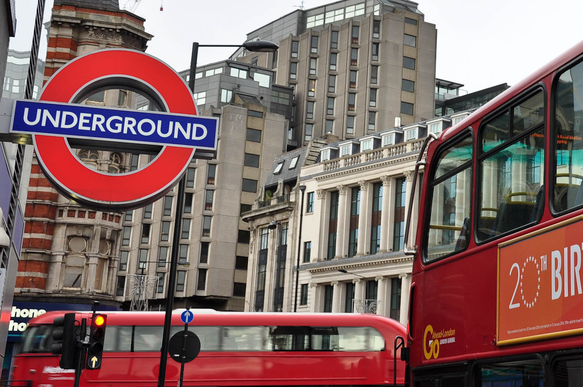 Double-decker busses with the London Underground logo, London, England