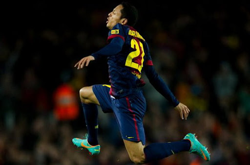 Barcelona player Adriano celebrates after scoring the equaliser against Atlético Madrid