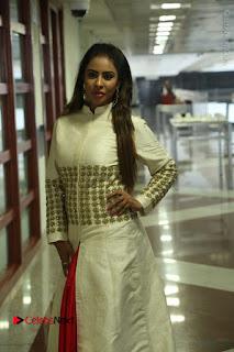 Telugu Actress Sri Reddy Mallidi Stills in White Beautiful Dress at Marriage Needs Bridal Fashion Week 2017 Logo Launch  0030.JPG