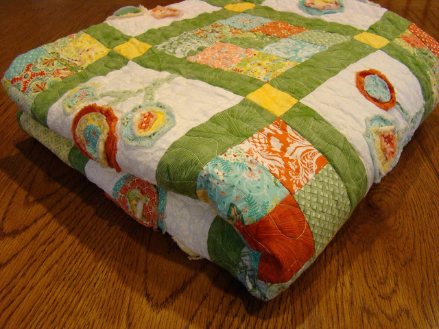 Bloom Where You Are Planted raw edge applique flower quilt