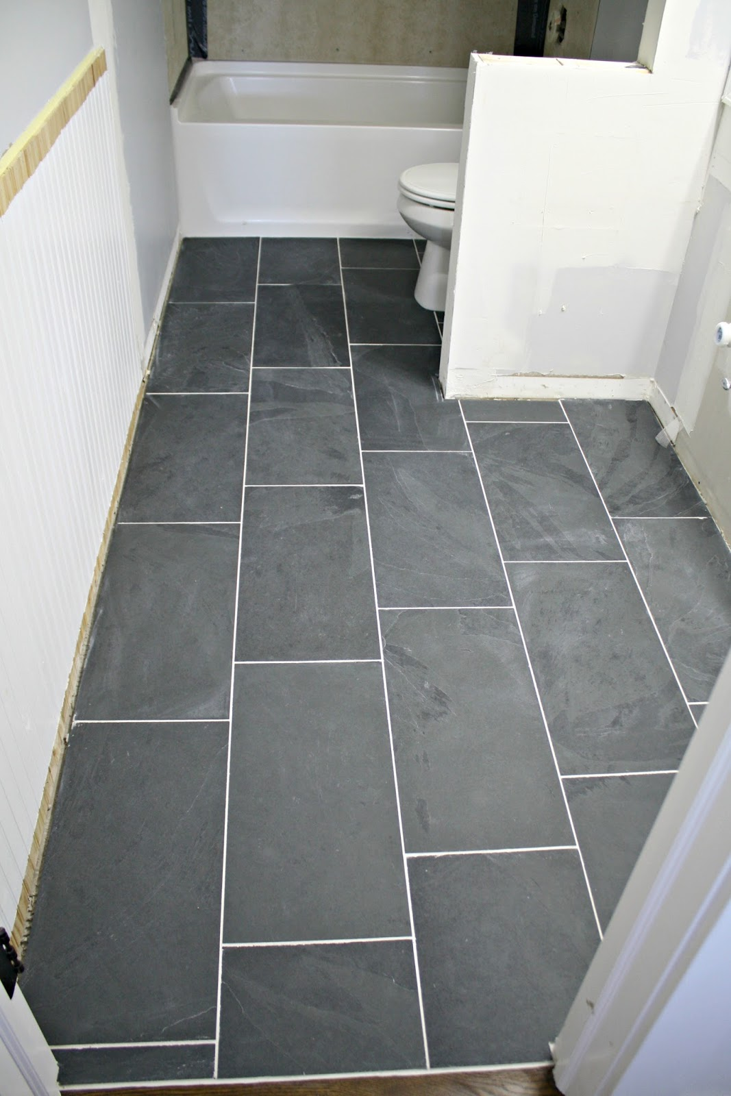 How to tile a bathroom floor it 39 s done white homes for 12x24 tile patterns floor
