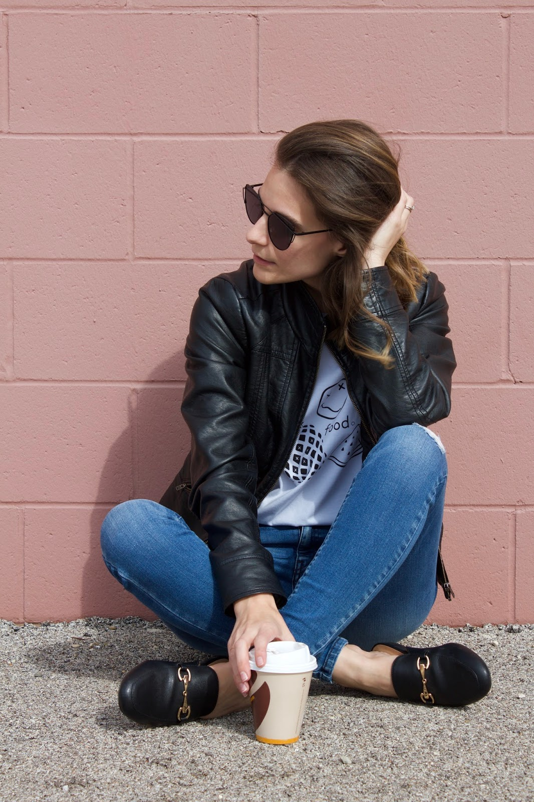 Black leather jacket with ripped jeans