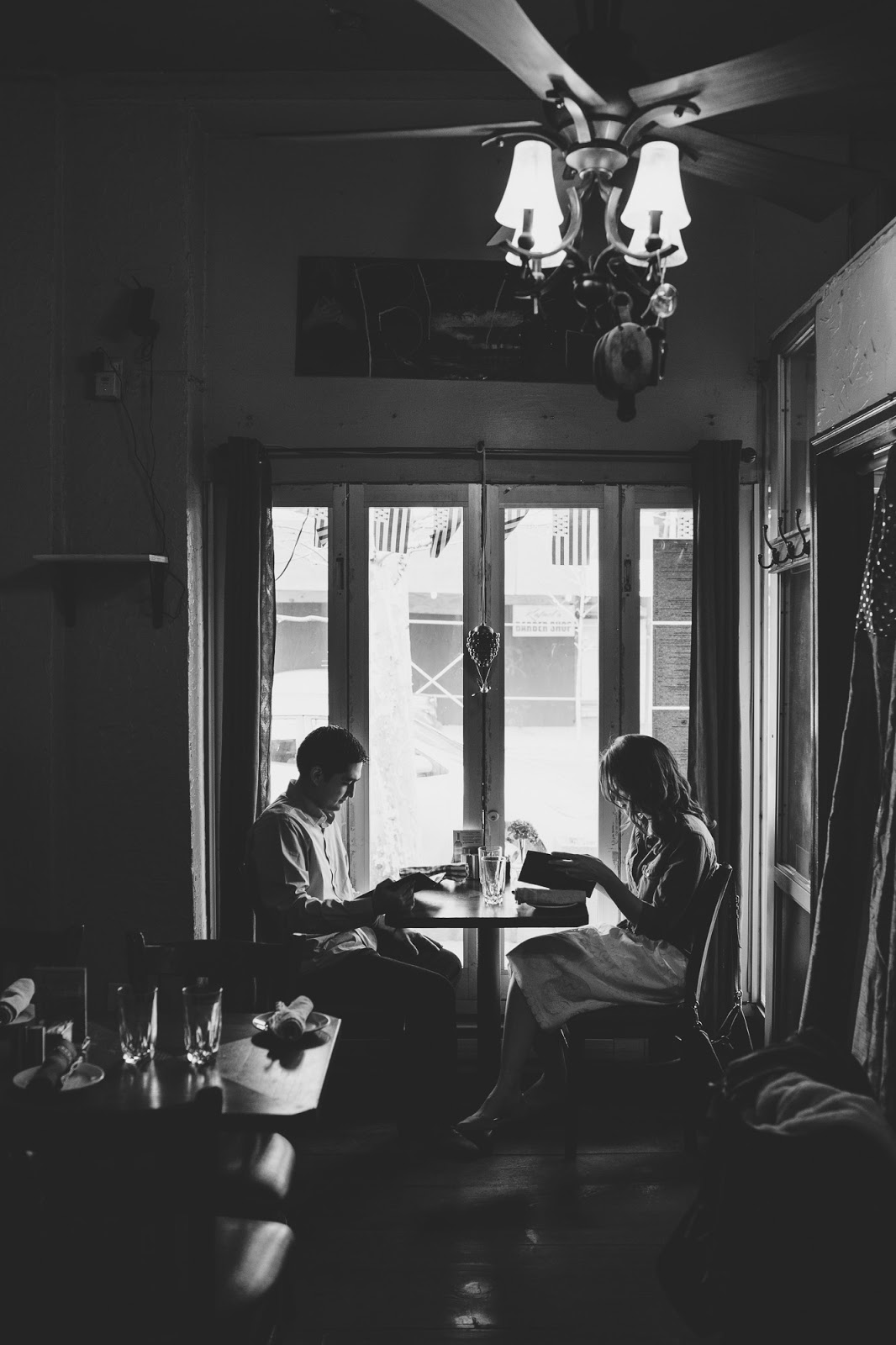 Intimate cafe engagement photos by Cassie Castellaw