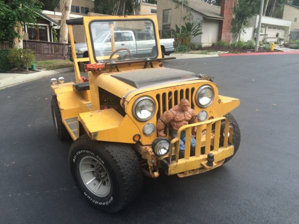 This is a CJ-5 that was modified to tow aircraft. Why not? Now that it's duties are over, it's just a really odd, narrow Jeep for the street or trail.